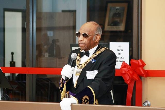 PGM Cash officiating the ribbon cutting ceremonies of the WMCTLM at Most Worshipful Prince Hall Grand Lodge Of Texas.